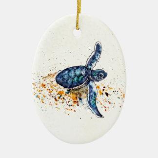 Ornement Ovale En Céramique Tortue de mer de bébé émergeant du sable