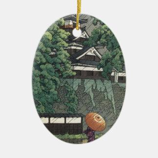 Ornement Ovale En Céramique Tour d'Udo, château de Kumamoto sous la pluie -