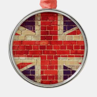 Ornement Rond Argenté Drapeau BRITANNIQUE vintage sur un mur de briques