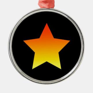 Ornement Rond Argenté Étoile orange lumineuse sur le noir