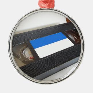 Ornement Rond Argenté Vidéocassette périmée. Vieille cassette vidéo sur