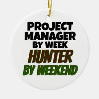 Ornement Rond En Céramique Chef de projet par le chasseur de semaine par