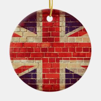 Ornement Rond En Céramique Drapeau BRITANNIQUE vintage sur un mur de briques