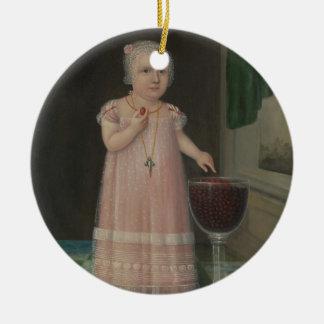 Ornement Rond En Céramique La petite fille déplaisante mange la sucrerie