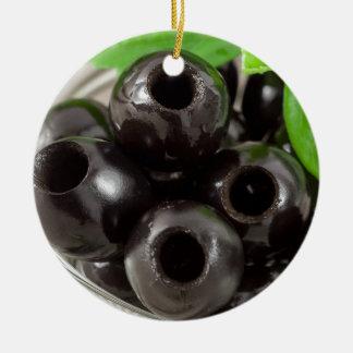 Ornement Rond En Céramique Macro vue détaillée des olives noires