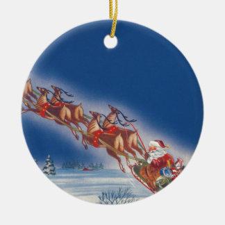 Ornement Rond En Céramique Noël vintage, Père Noël pilotant le renne de