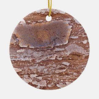 Ornement Rond En Céramique Surface d'un grès rouge avec les geods siliceux