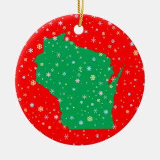 Ornement Rond En Céramique Vert de fête sur la carte rouge des flocons de