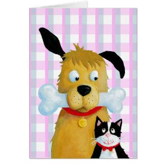 Os et chat de chien sur le motif de tartan - carte