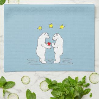 Ours blancs donnant des étoiles de coeur et de serviettes éponge