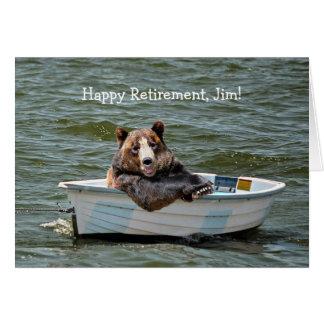 Ours de retraite dans le bateau carte de vœux