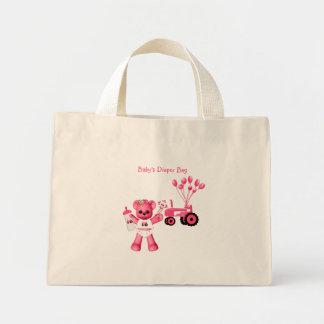 Ours de roses pâles et sac rose de tracteur