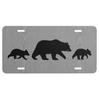 Ours gris avec des silhouettes de CUB
