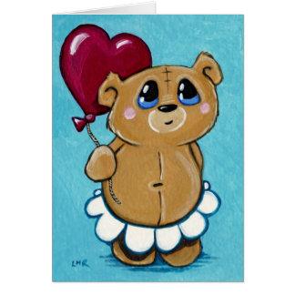 Ours mignon tenant la carte de Valentine de ballon