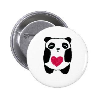 Ours panda avec une goupille de coeur pin's