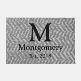 Paillasson Arête de hareng grise moderne et monogramme noir