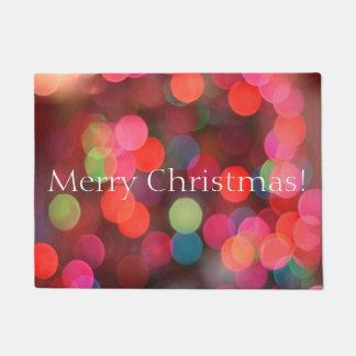 Paillasson Bokeh coloré allume la salutation de Joyeux Noël