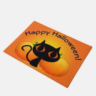 Paillasson Kitty noir et citrouilles sur l'orange