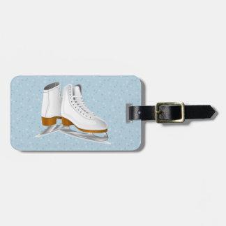 paires de patins de glace blancs étiquettes bagages