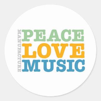 Paix, amour, et musique de fabrication sticker rond