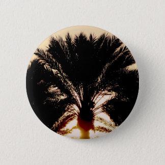 Palmiers de coucher du soleil badges