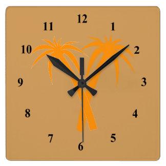 Palmiers élégants dans le désert horloge carrée