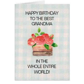 Panier des roses rouges sur la grand-maman carte de vœux