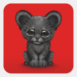 Panthère noire CUB de bébé mignon sur le rouge Sticker Carré