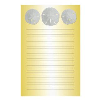 Papeterie Dollars de sable sur le papier à lettres rayé par