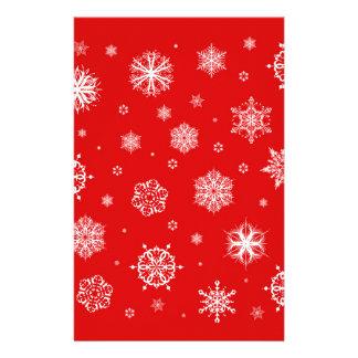 Papeterie Flocons de neige blancs sur l'arrière - plan rouge