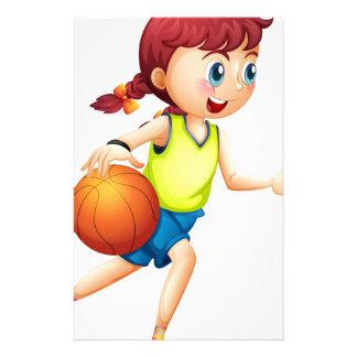 Papeterie Une jeune fille jouant au basket-ball