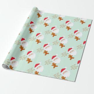 Papier Cadeau Père Noël font face au garçon de pain d'épice