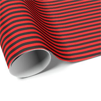 Papier d'emballage mince de rayures rouges et papier cadeau noël