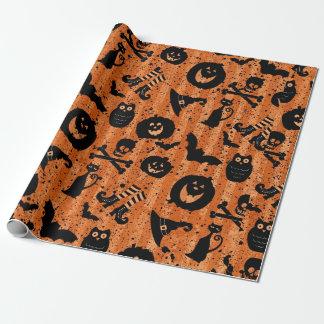 Papier orange de hibou de casquette de sorcière de papier cadeau noël