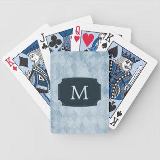 Papier peint bleu décoré d'un monogramme de diaman jeu de cartes