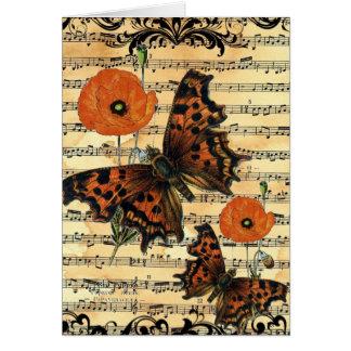 Papillon européen avec la carte de voeux de pavot