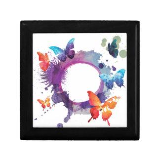 Papillons en pastel d'aquarelle autour d'un anneau boîte à souvenirs