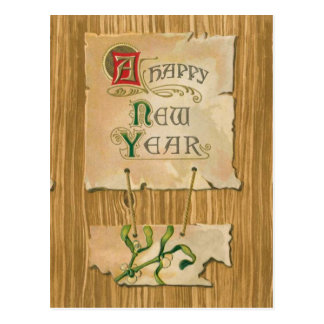 Parchemin et gui de bonne année sur des bois de carte postale