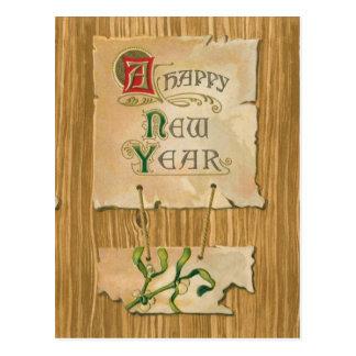 Parchemin et gui de bonne année sur des bois de cartes postales
