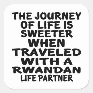 Parcouru avec un associé rwandais de la vie sticker carré