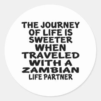 Parcouru avec un associé zambien de la vie sticker rond