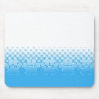 Pattes bleues et blanches avec l'arrière - plan de tapis de souris
