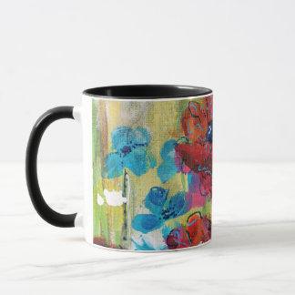 Pavots avec la tasse bleue