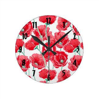 Pavots rouges de nouveau aux bases de dortoir horloge ronde