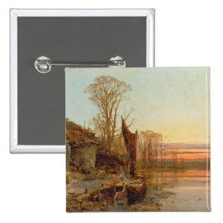 Paysage avec un cottage ruiné au coucher du soleil badge