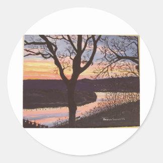Peinture de coucher du soleil de la rivière sticker rond