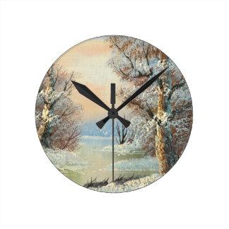 Peinture d'une forêt et d'une rivière d'hiver horloge murale
