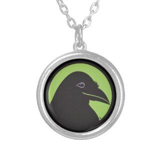 Pendentif noir de logo de bases de Raven