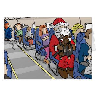 Père Noël dans la carte de voeux d'avion