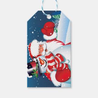 Père Noël et étiquette de cadeau de metteur en
